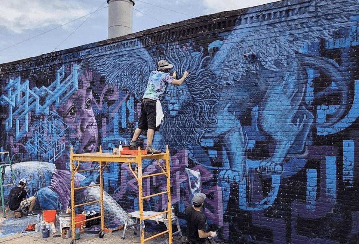 Creating Purple Dream Mural by Marc Evan